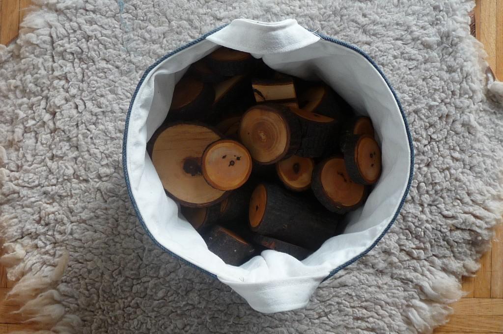bucket with wood blocks