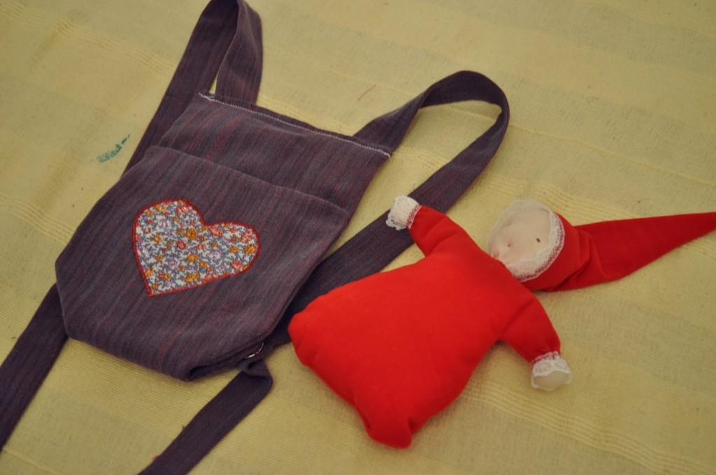 sling + doll